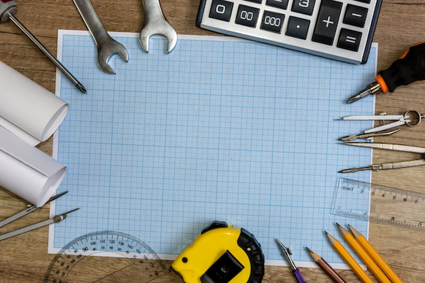 Drawing tools with millimeter paper on wooden table
