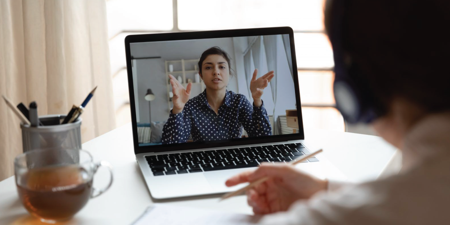 Employee on video call with a co-worker