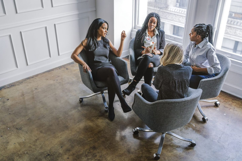 Professional businesswomen talking