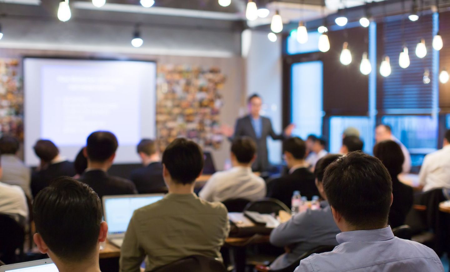Business people meeting and working while business executive lead presenter speaks to group of successful technology entrepreneurs consultant advisor growth training lecture defocused blurred