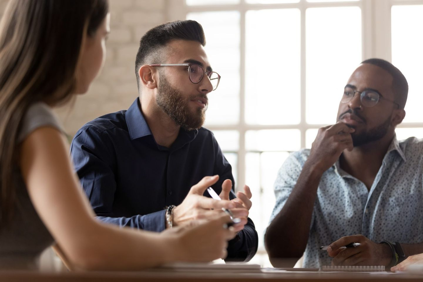 Multiethnic colleagues talk discussing business ideas at meeting