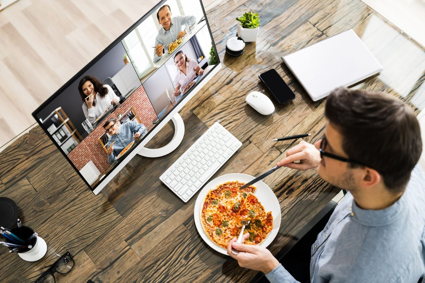 Man eating dinner while on zoom