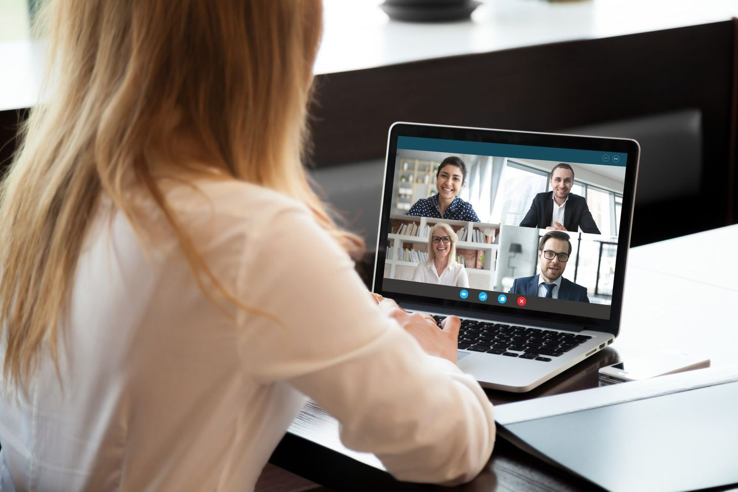 Female employee have team web conference on laptop