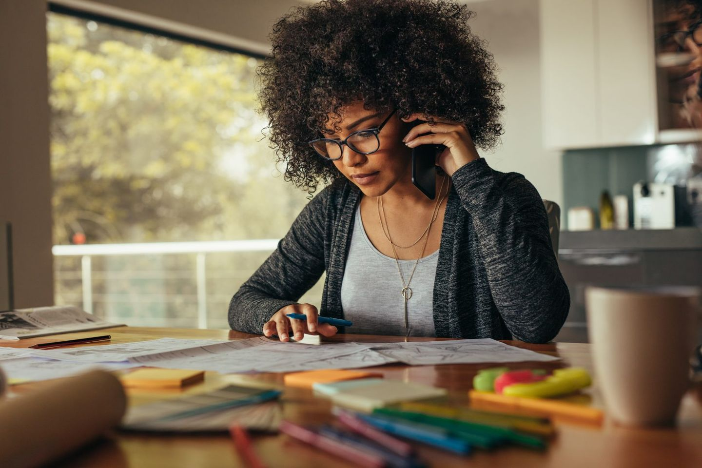 Female architect talking over phone