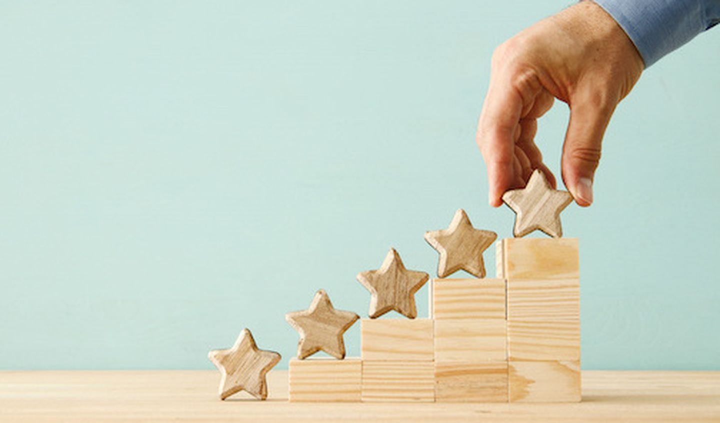 Concept image of setting a five star goal increase rating or ranking evaluation and classification idea 2