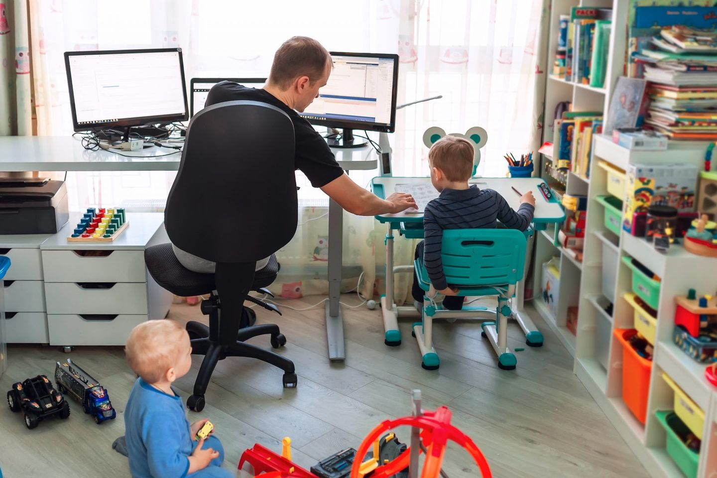 Father with kids working from home during quarantine stay at home work from home concept during coronavirus pandemic