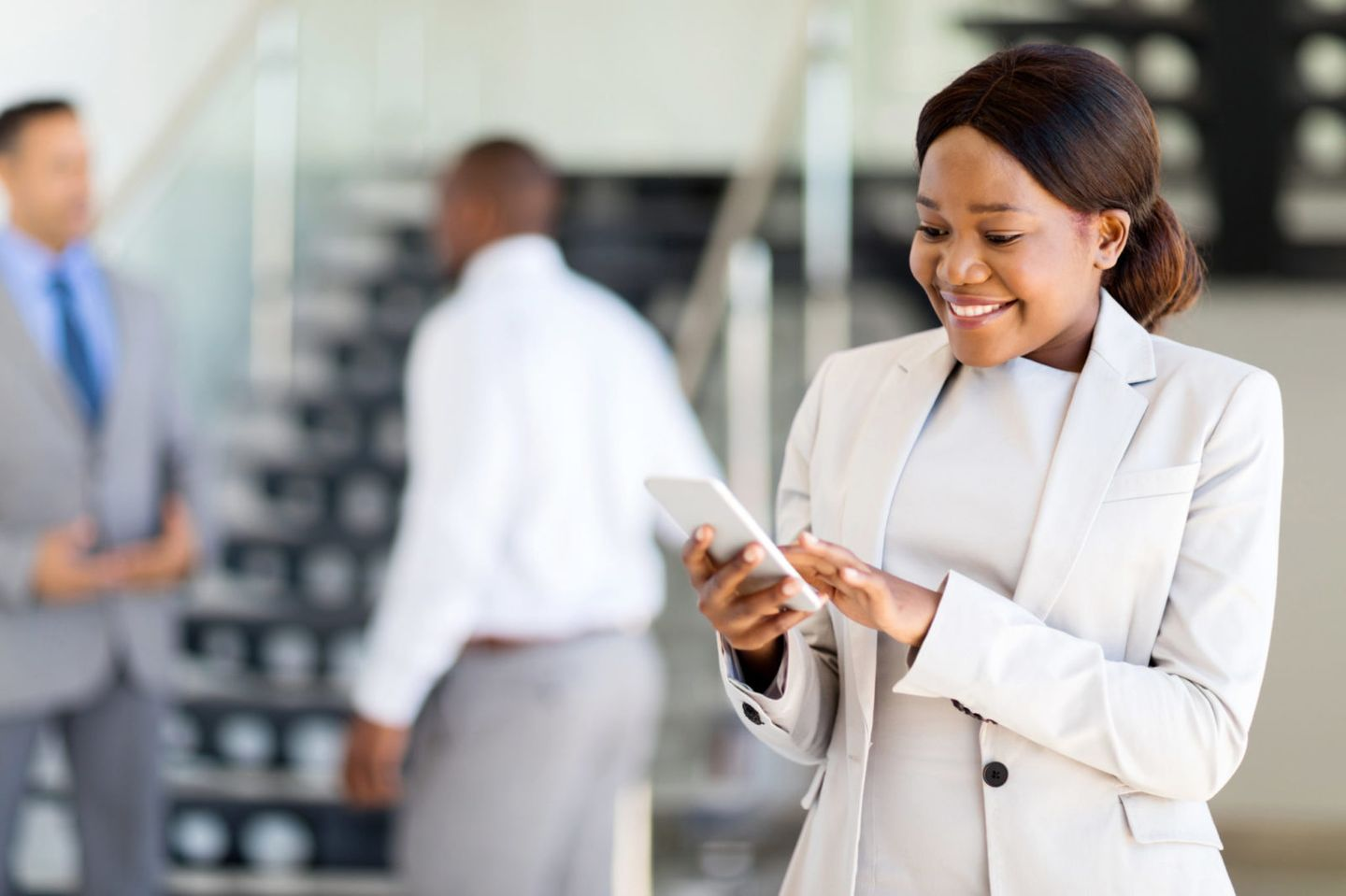 Young african american career woman using cell phone
