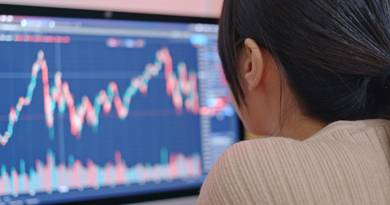 Woman study the stock market data