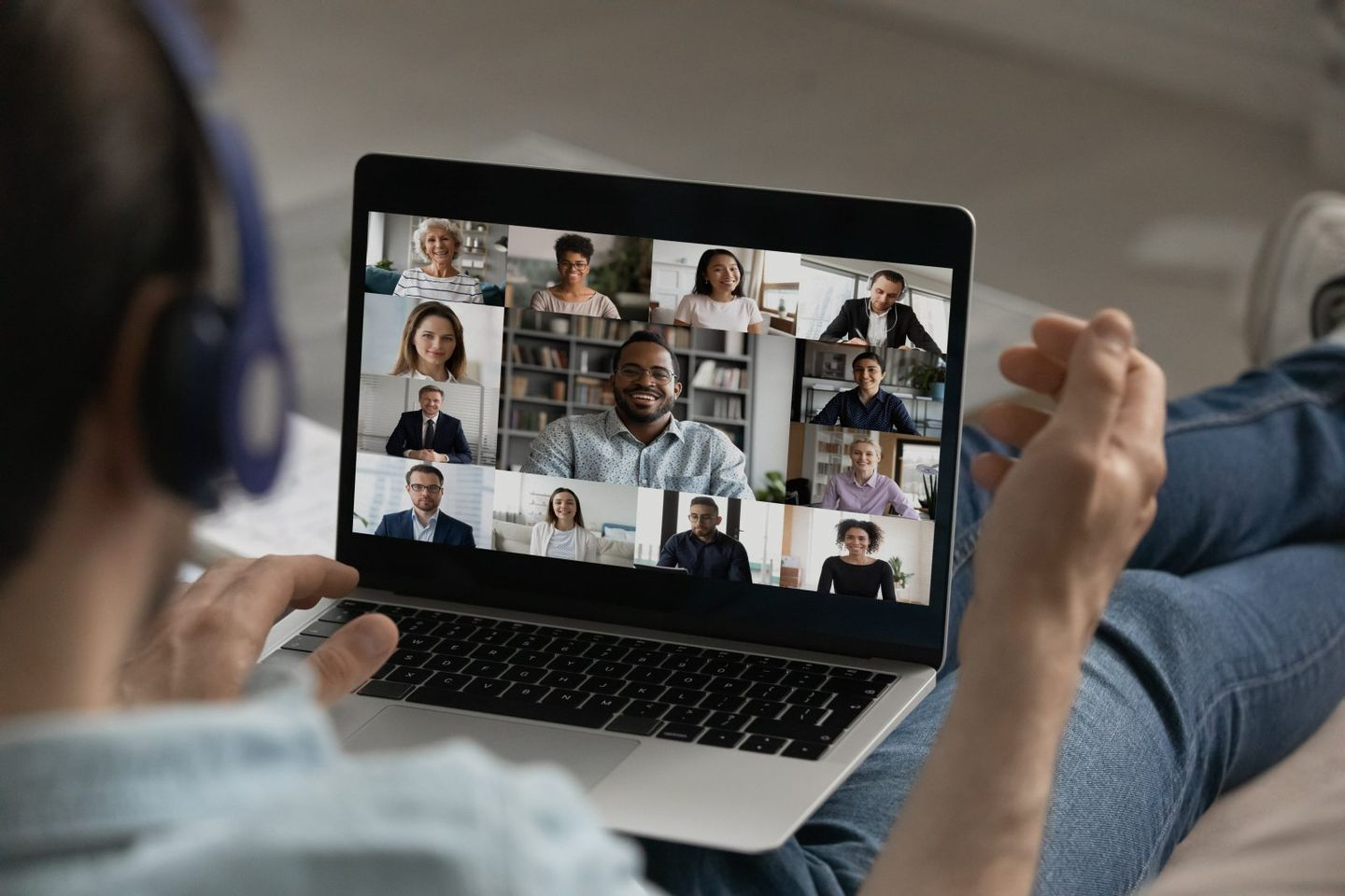 Male employee have group video call with colleagues